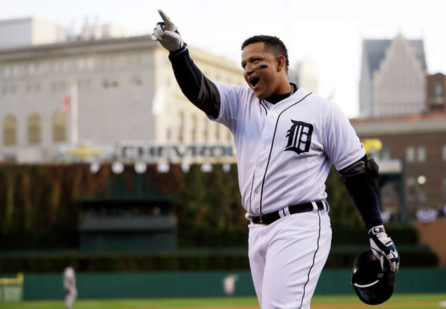 FILE - In this Oct. 18, 2012, file photo, Detroit Tigers' Miguel Cabrera celebrates after hitting a two-run home run during the fourth inning of Game 4 of the American League championship series against the New York Yankees in Detroit. Cabrera and Mike Trout are the top contenders for the American League Most Valuable Player award, to be announced Thursday, Nov. 15, 2012. (AP Photo/Matt Slocum, File) / AP