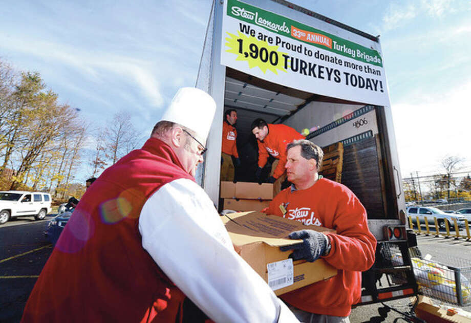 """Michael Luboff, Andrew Colton and Rob Jevarjian help as Stew Leonard's 33rd Annual """"Turkey Brigade"""" distributes 1,929 turkeys to more than 100 churches, civic groups, elderly housing and senior nutrition programs, and schools the Norwalk and other communities that Stew Leonard'ss serve to help provide Thanksgiving day meals for families in need.Hour photo / Erik Trautmann / (C)2012, The Hour Newspapers, all rights reserved"""
