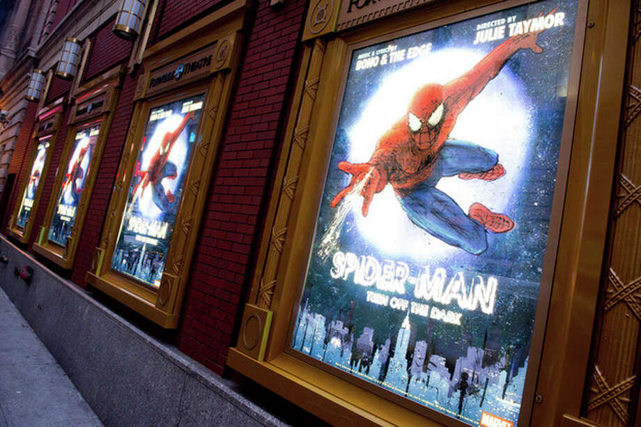 "FILE - In this Dec. 22, 2010 file photo, posters for the Broadway musical ""Spider-Man Turn: Off the Dark"" hang outside the Foxwoods Theatre in New York. A spokesman for the show says an actor on the set of the Broadway musical was injured during a night performance, Thursday, Aug. 15, 2013. The performance was halted. The actor, who was taken to Bellevue Hospital with a serious leg injury, was not identified. (AP Photo/Charles Sykes, File) / SYKEC"