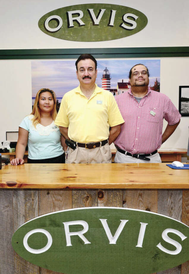Store manager Nick Douglas flanked by key holders Rita Khongmany and Phil Taliaferro a the new Orvis location on Westport Avenue in Norwalk.Hour photo / Erik Trautmann