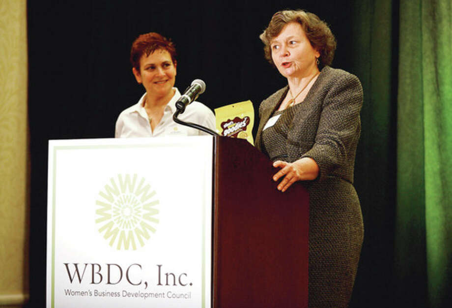 Peg Sheehan, Women's Business Development Council Board Chair, awards the Deb Ziegler Award to Liz Gilbert of Gilbert Gourmet Goodies LLC at the WBDC's Annual Business Breakfast at the Stamford Marriott Thursday.Hour photo / Erik Trautmann / (C)2012, The Hour Newspapers, all rights reserved
