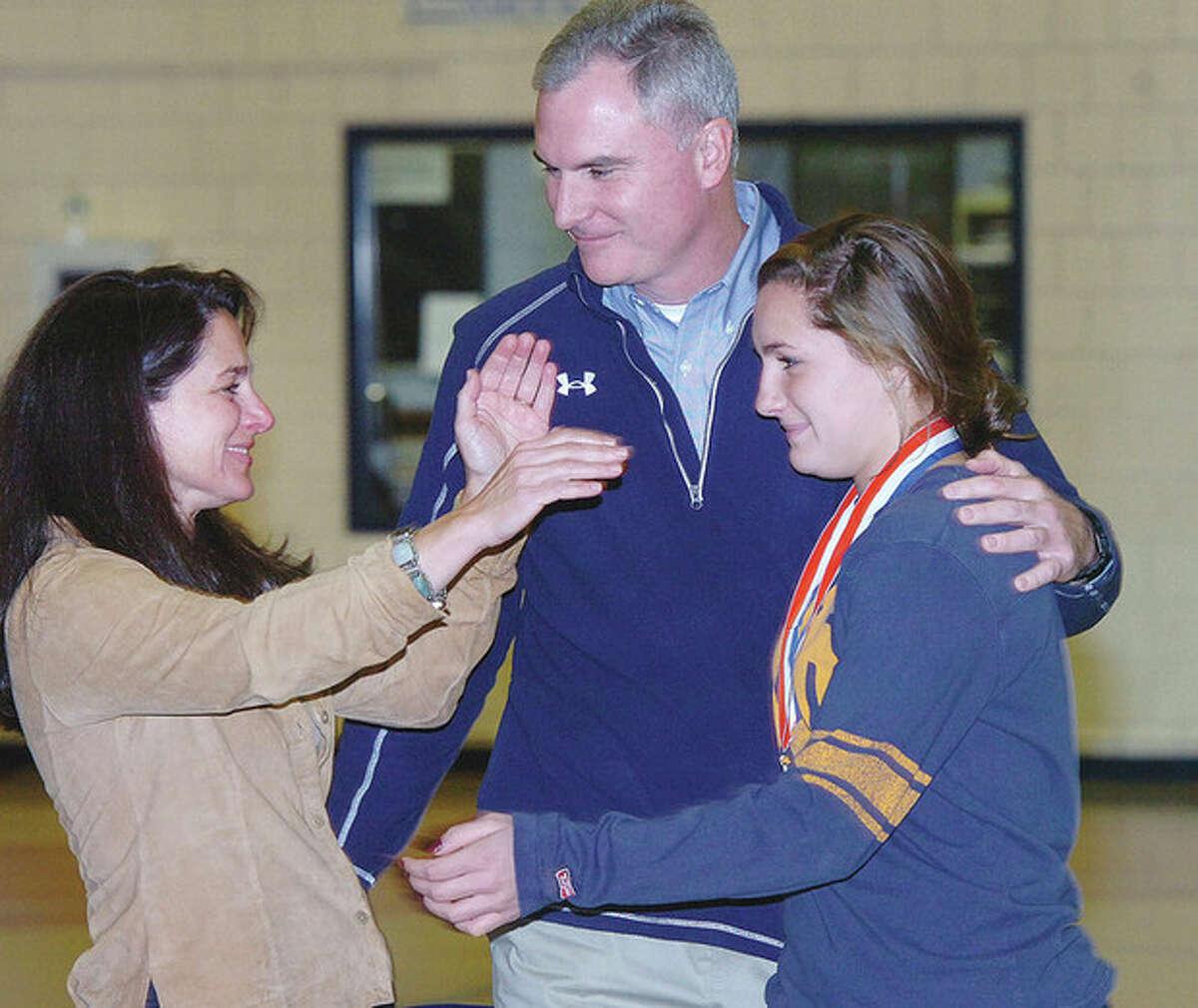 Hour Photo Alex von Kleydorff; Parents Karen and Steve embrace Casey Pearsall at the Wendy's Heisman Trophy announcement