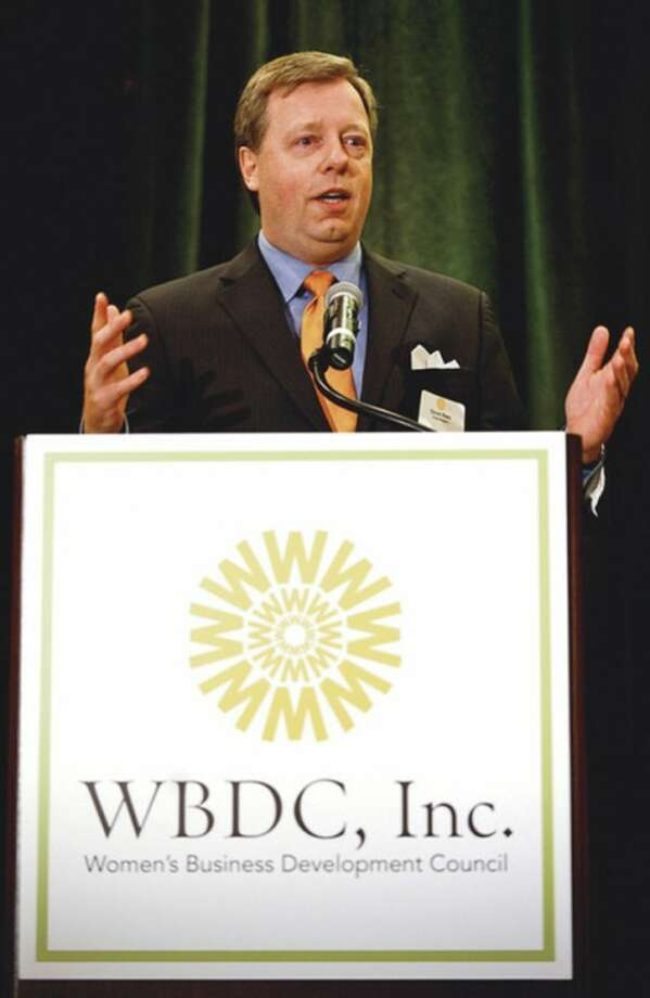 David Ring, Managing Director of Enetrprise Banking and NE Regional President of First Niagra Bank, makes his remarks at the Women's Business Development Council (WBDC) annual Business Breakfast at the Stamford Marriott Thursday.Hour photo / Erik Trautmann