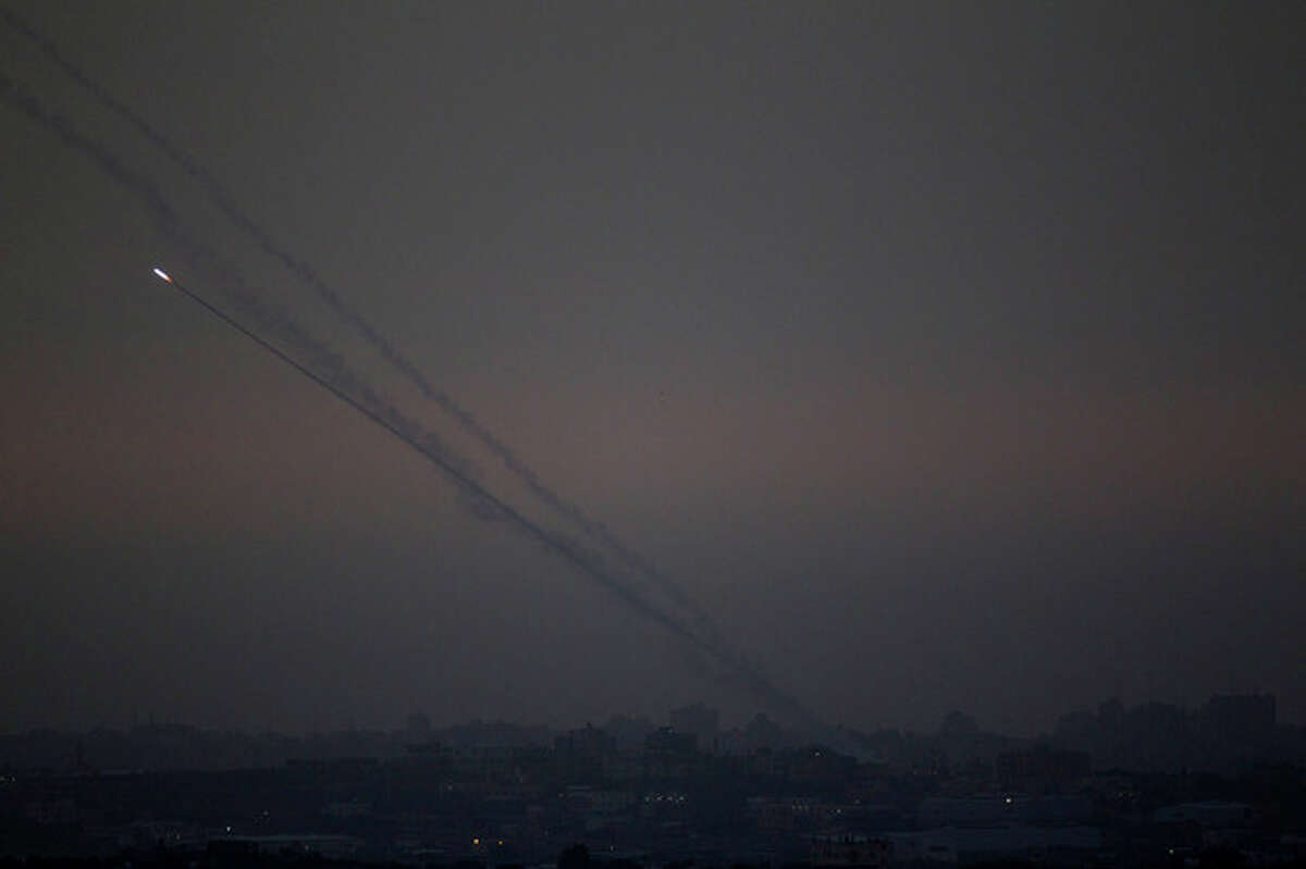 """Rockets lunched by Palestinian militants towards Israel make their way from the northern Gaza Strip, as seen from the Israel Gaza Border, southern Israel, Saturday, Nov. 17, 2012. The Israeli military says its """"Iron Dome"""" rocket-defence system has shot down an incoming projectile bound for Tel Aviv. (AP Photo/Ariel Schalit)"""