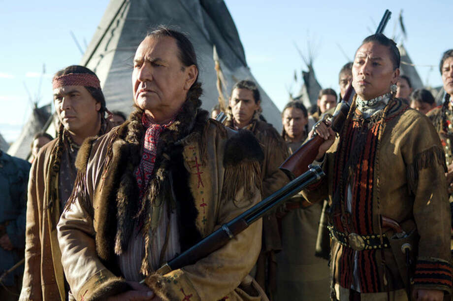 "FILE - This undated file photo supplied by HBO shows actors Eric Schweig, left, August Schellenberg and Nathan Chasing Horse, right, in the HBO film ""Bury My Heart at Wounded Knee."" Schellenberg, who starred in the ""Free Willy"" films and appeared in numerous television roles, has died at his Dallas home after a fight with lung cancer, his agent said Friday. He was 77. (AP Photo/HBO, Annabel Reyes, File) / HBO"