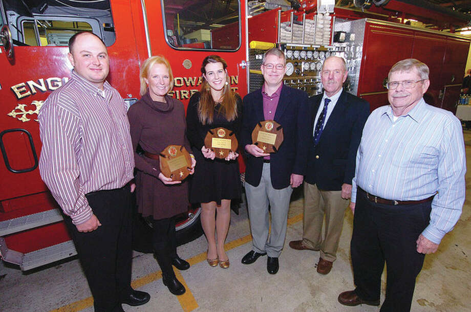 Hour Photo Alex von Kleydorff; Rowayton Volunteer Fore dept. Assistant Chief Todd Deklyn, Rookie's of the year Silvia Doyle and Sarah Whitman, Firefighter of The Year Doug Morrison, Chief Ed Carlson and President Jack Raymond / 2012 The Hour Newspapers