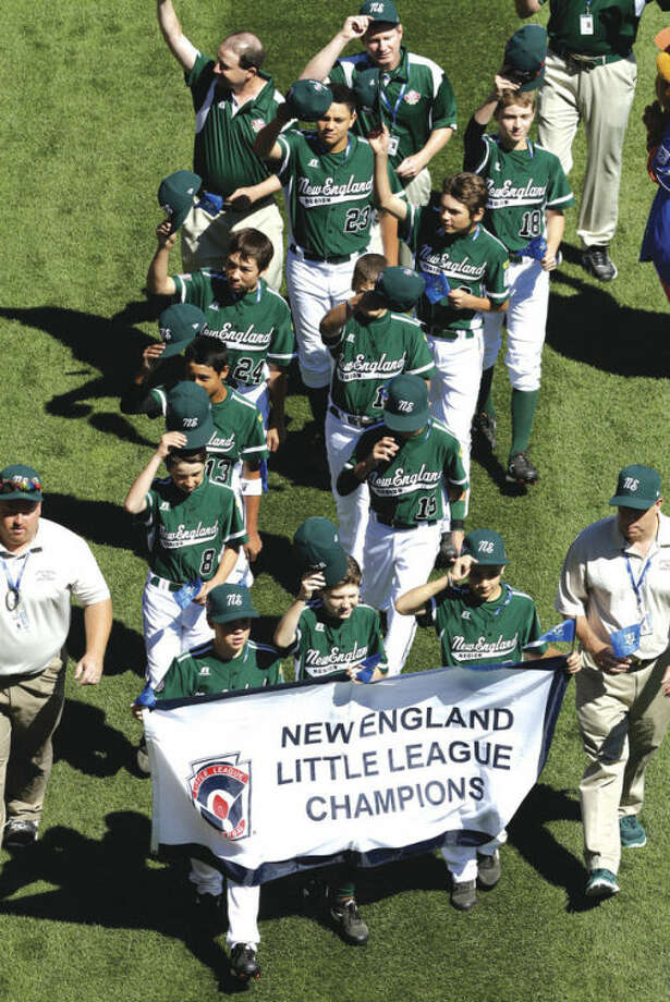 AP photoThe Westport team participates in Thursday's opening ceremony for the 2013 Little League World Series in South Williamsport, Pa. For two families, the Browns and the Azadians, the hoopla has a familiar ring.