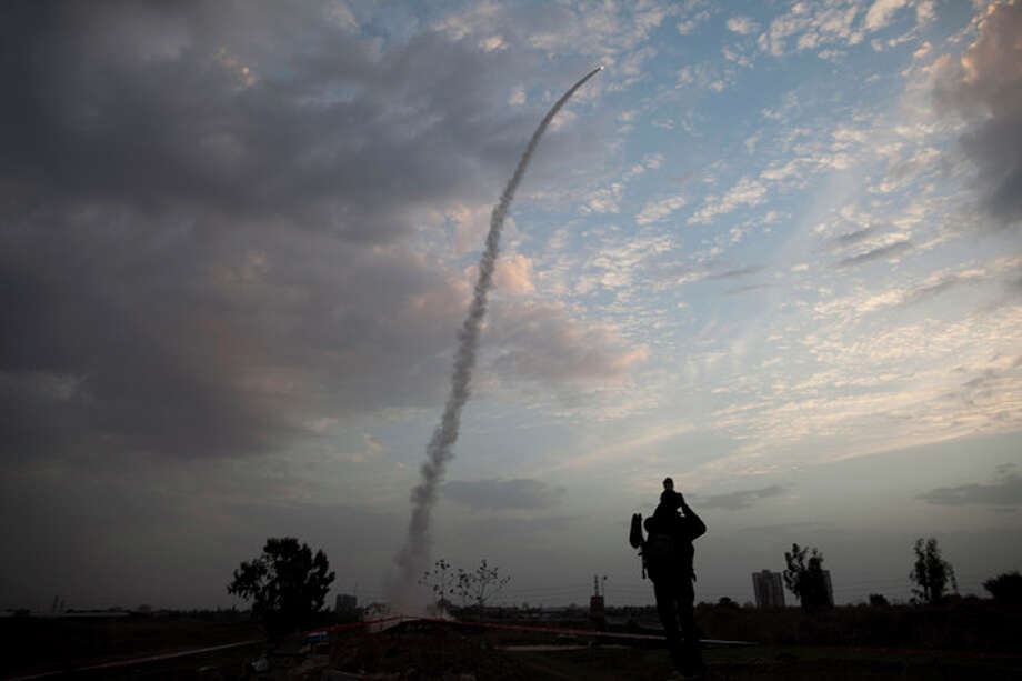 An Iron Dome missile is launched in Tel Aviv, to intercept a rocket fired from Gaza, Saturday, Nov. 17, 2012. Israel bombarded the Hamas-ruled Gaza Strip with nearly 200 airstrikes early Saturday, the military said, widening a blistering assault on Gaza rocket operations to include the prime minister's headquarters, a police compound and a vast network of smuggling tunnels. (AP Photo/Oded Balilty) / AP