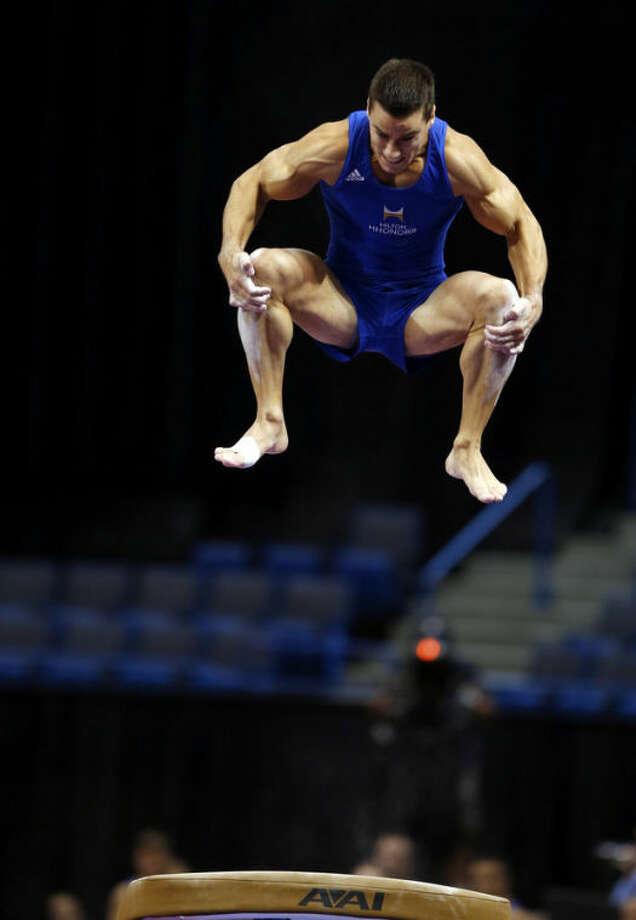 Jake Dalton competes on the vault during the U.S. men's national gymnastics championships in Hartford, Conn., Friday, Aug. 16, 2013. (AP Photo/Elise Amendola)