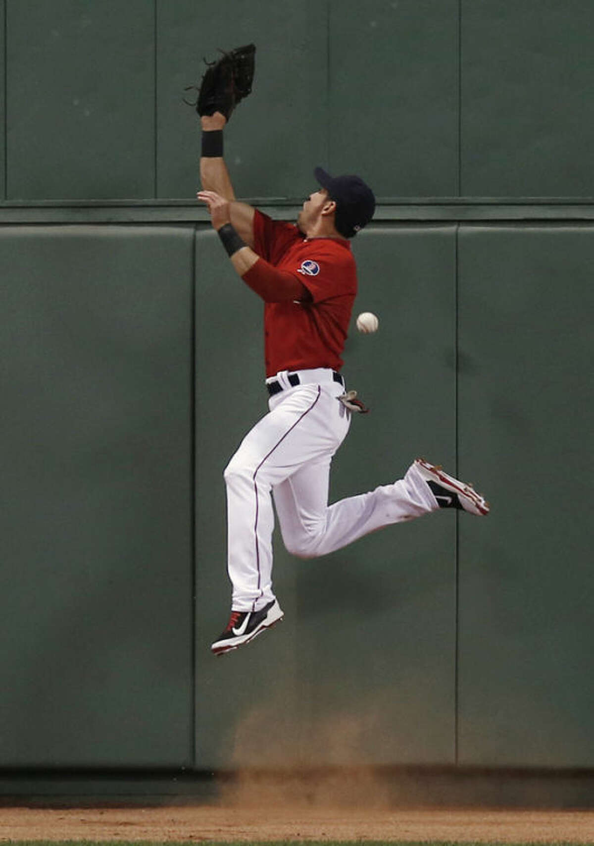 Boston Red Sox center fielder Jacoby Ellsbury can't catch a triple by New York Yankees' Eduardo Nunez during the fourth inning of a baseball game at Fenway Park in Boston Friday, Aug. 16, 2013. (AP Photo/Winslow Townson)