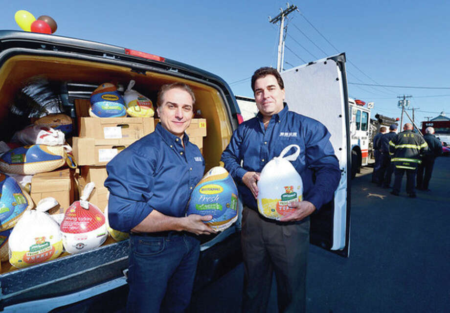 "Steve Bowling and Rich Cunningham of Ed's Garage Doors in South Norwalk load up donated turkey's as Ed's hosts ""Operation Turkey: Feeding Fairfield County Families"" to help families in need this holiday season. 100 turkeys will be donated.Hour photo / Erik Trautmann / (C)2012, The Hour Newspapers, all rights reserved"