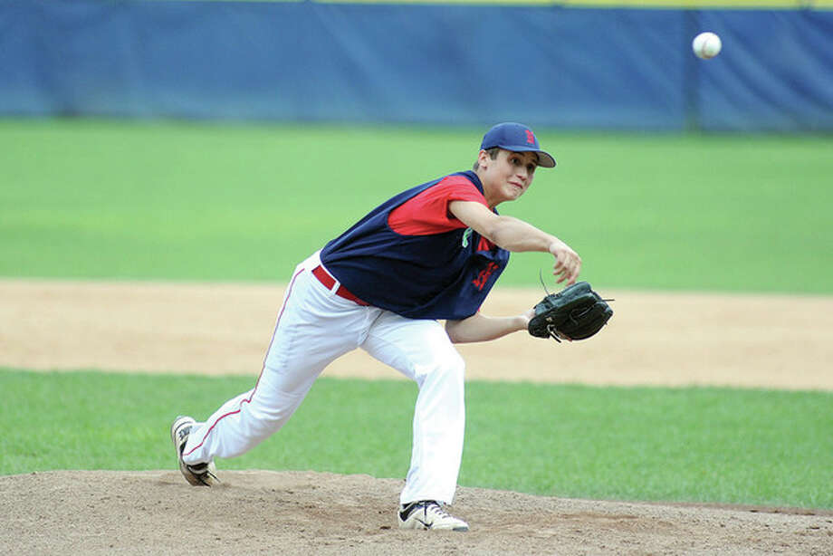 Hour photo/John NashTourney MVP Mike Gonzalez delivers a pitch for Norwalk District in Friday's Sharkey Laureno tournament championship game against Norwalk Bravest. The District squad won, 6-1.