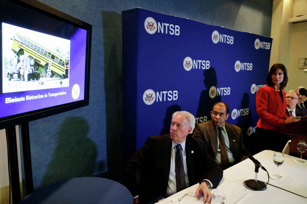 """National Transportation Safety Board (NTSB) Chair Deborah Hersman, third from right, along with board members, from left: Earl F. Weener; Christopher A. Hart; Robert L. Sumwalt; and Mark R. Rosekind watch a video a news conference regarding its 2013 """"Most Wanted List"""" of transportation challenges, Wednesday, Nov. 14, 2012, during a news conference at the National Press Club in Washington. (AP Photo/Charles Dharapak)"""