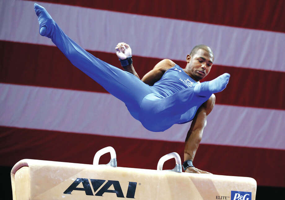 AP photoReigning champion John Orozco competes on the pommel horse during Friday's U.S. men's national gymnastics championships in Hartford. / AP