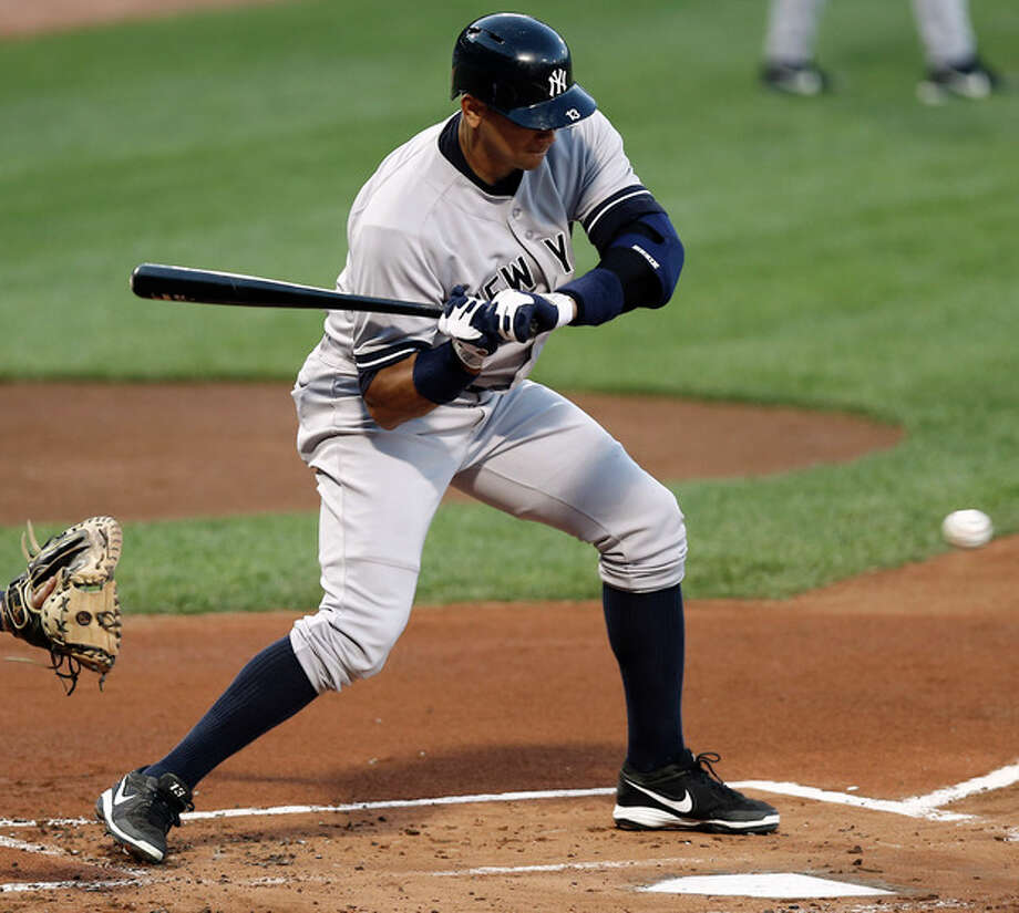 New York Yankees' Alex Rodriguez watches a called strike during his first at-bat during the first inning of a baseball game against the Boston Red Sox at Fenway Park in Boston on Friday, Aug. 16, 2013. (AP Photo/Winslow Townson) / FR170221 AP
