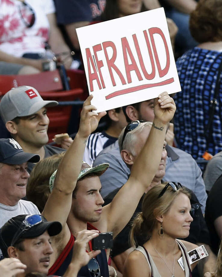 A fan holds up a sign as New York Yankees' Alex Rodriguez comes up to bat during the first inning of a baseball game against the Boston Red Sox at Fenway Park in Boston on Friday, Aug. 16, 2013. (AP Photo/Winslow Townson)