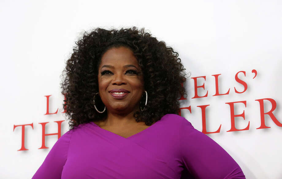 """Oprah Winfrey arrives at the Los Angeles premiere of """"Lee Daniels' The Butler"""" at the Regal Cinemas L.A. Live Stadium 14 on Monday, Aug. 12, 2013. (Photo by Matt Sayles/Invision/AP) / Invision"""