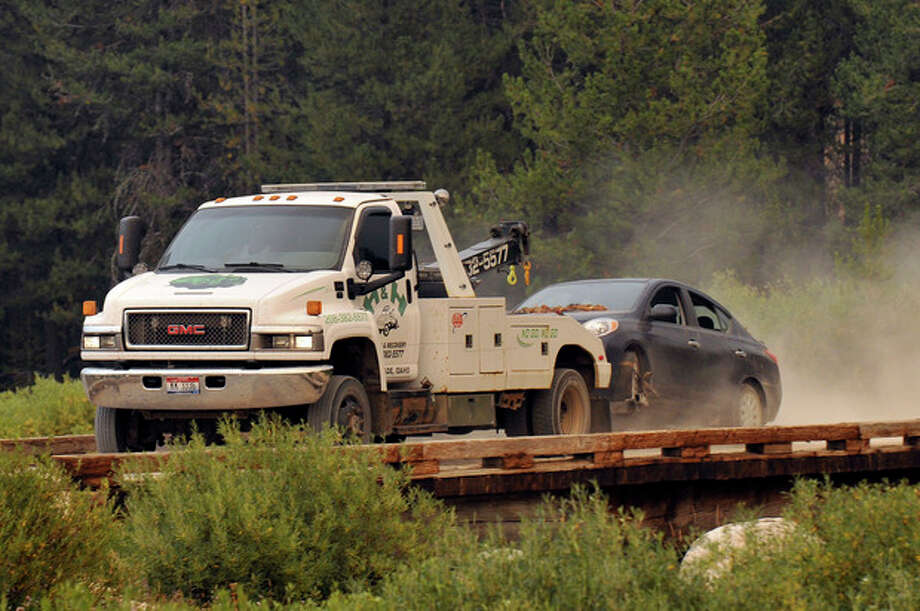James Dimaggio's car is towed to the town of Cascade after dectives finished searsching it on a trail head bordering the Frank Church River of No Return Wilderness on Saturday, Aug. 10, 2013. Dimaggio, 40, is suspected of killing a California woman and her young son and then fleeing with the 16-year-old daughter was found in the Idaho wilderness on Friday after horseback riders reported seeing the man and girl hiking in the area two days earlier, authorities said. (AP Photo/Robby Milo) / FR170811 AP