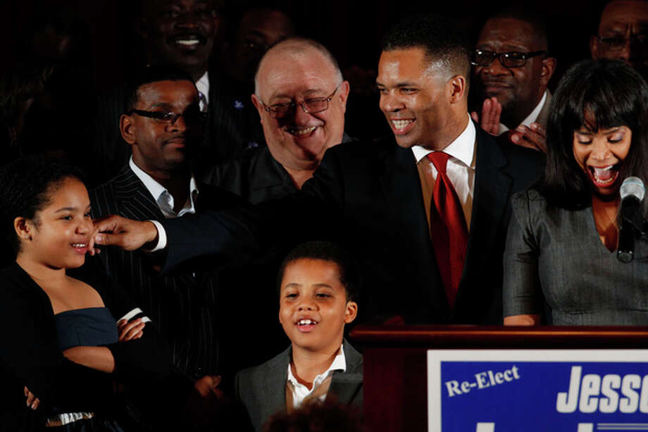 FILE - This March 20, 2012 file photo shows Rep. Jesse Jackson Jr., D-Ill., his wife Chicago Alderman Sandi Jackson, and their children Jessica, 12, and Jesse III, 8, thanking supporters at his election night party in Chicago after his Democratic primary win over challenger, former Rep. Debbie Halvorson, in the Illinois' 2nd District. A spokesman for House Speaker John Boehner says he has received letter of resignation from Rep. Jesse Jackson Jr. Wednesday. (AP Photo/M. Spencer Green, File) / AP