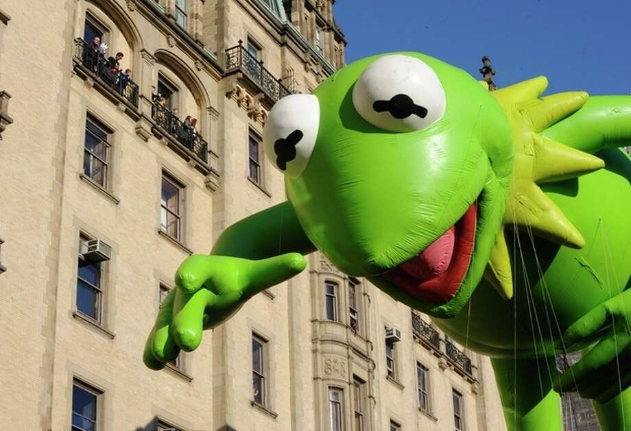 The Kermit The Frog balloon makes its way down New York's Central Park West in celebration of the 86th annual Macy's Thanksgiving Day Parade,Thursday, Nov 22, 2012. (AP Photo/ Louis Lanzano) / FR77522 AP