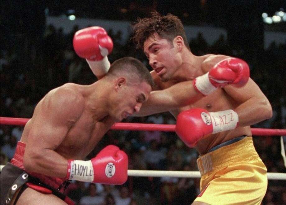 FILE - This Sept. 13, 1997 file photo shows Hector Camacho, left, of Puerto Rico, and Oscar De La Hoya of Los Angeles exchanging blows in the first round of their WBC welterweight championship in Las Vegas. Police in the Puerto Rican city of Bayamon say they found drugs inside the car in which former champion boxer Camacho was shot and critically wounded. Camacho was in critical condition Wednesday, Nov. 21, 2012, at the Centro Medico trauma center in San Juan. (AP Photo/Mike Salsbury, File) / AP