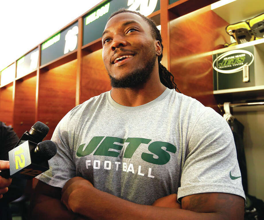 AP photoNew York Jets running back Chris Ivory talks to reporters in front of his locker last spring at the team's practice facility in Florham Park, N.J. Ivory, expected to be the Jets' No. 1 running back this season, is hoping to make his preseason debut Saturday. / FR27227 AP