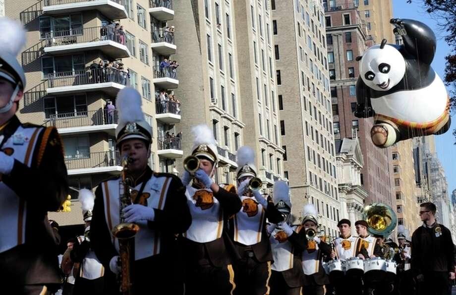 The Kung Fu Panda balloon, right, participates in the 86th annual Macy's Thanksgiving Day Parade,Thursday, Nov 22, 2012, in New York. (AP Photo/ Louis Lanzano) / FR77522 AP