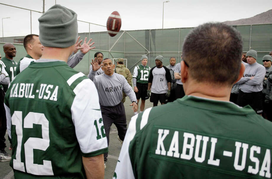 U.S. Army Master Sgt. Wade Manol explains the rules of football to players during a six-team competition to mark Thanksgiving at the U.S.-led coalition base in Kabul, Afghanistan, Thursday, Nov. 22, 2012. (AP Photo/Musadeq Sadeq) / AP