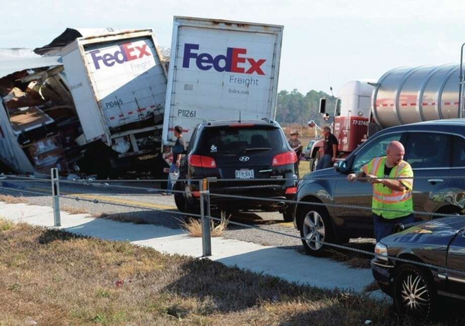 Cars and Trucks are piled on Interstate 10 in Southeast Texas Thursday Nov. 22, 2012. The Texas Department of Public Safety says at least 35 people have been injured in a more than 50-vehicle pileup. (AP Photo/The Beaumont Enterprise, Guiseppe Barranco) / The Beaumont Enterprise