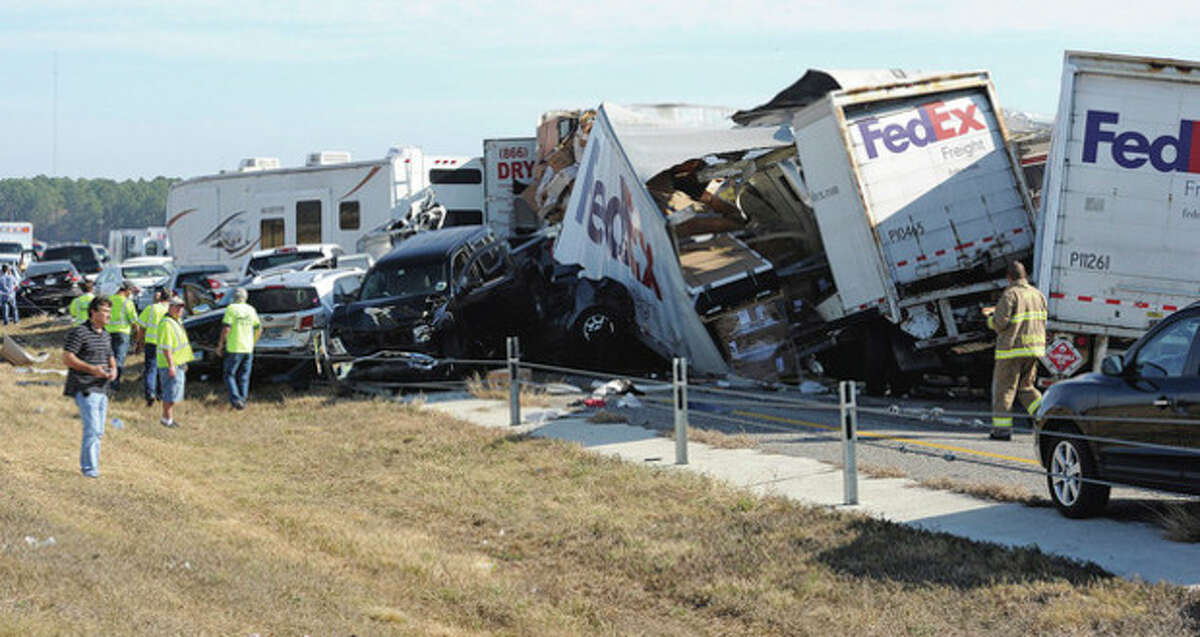 Cars and Trucks are piled on Interstate 10 in Southeast Texas Thursday Nov. 22, 2012. The Texas Department of Public Safety says at least 35 people have been injured in a more than 50-vehicle pileup. (AP Photo/The Beaumont Enterprise, Guiseppe Barranco)