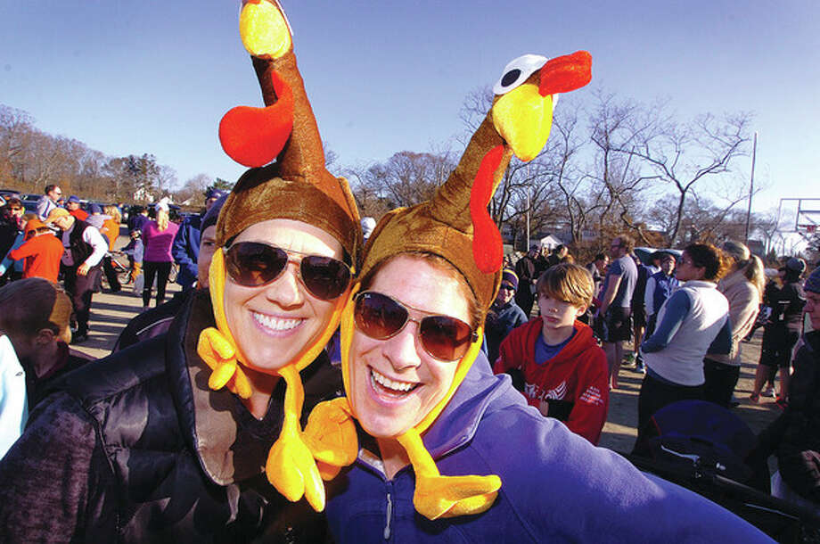 Hour photo / Alex von KleydorffFrom left, Melissa Wanger and Heather Raker share similar taste in hats, at least during one day of the year, for Rowayton's Turkey Trot on Thanksgiving. / 2012 The Hour Newspapers