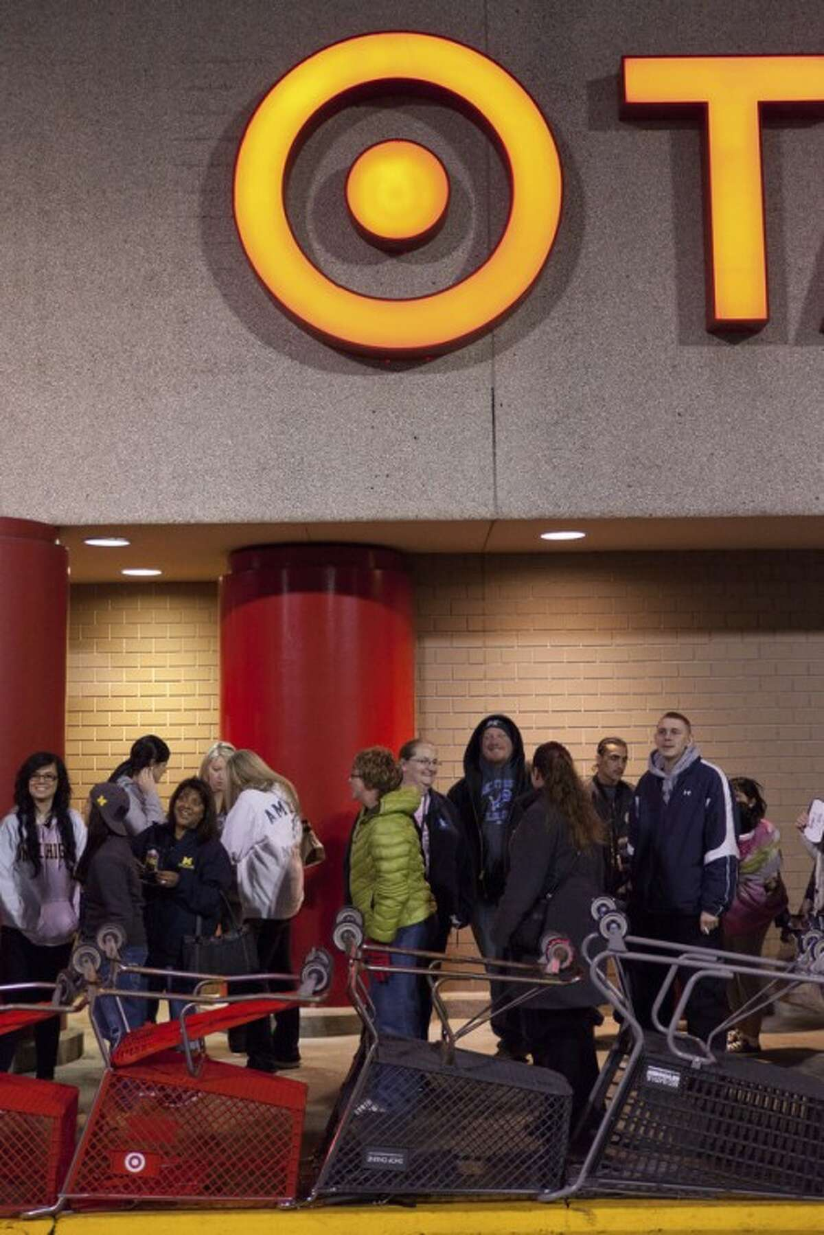 Shoppers wait in line outside of Target prior to them opening Thursday Nov. 22, 2012 at 9 p.m. for their Black Friday sales event in Flint, Mich. (AP Photo/Flint Journal, Griffin Moores)