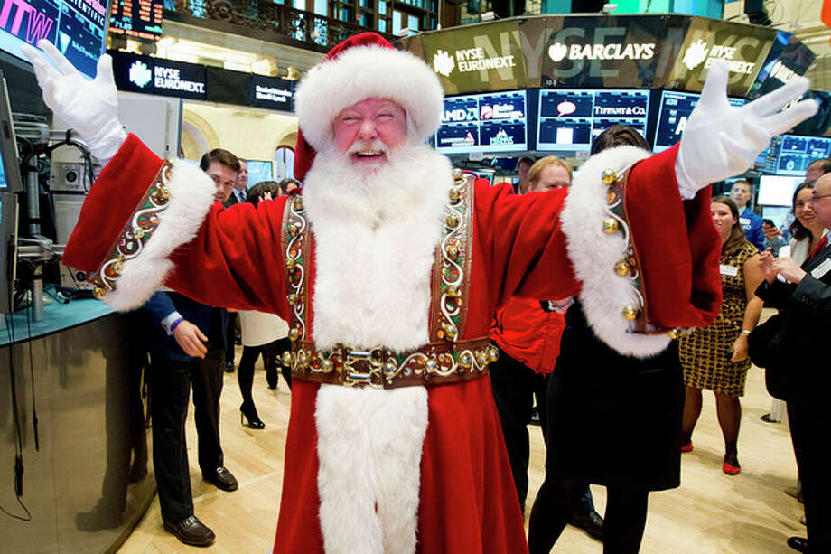 In this photo provided by the New York Stock Exchange, a man portraying Santa Claus visits the trading floor of the New York Stock Exchange, Wednesday Nov. 21, 2012 before he participated in opening bell ceremonies featuring the Macy's Thanksgiving Day Parade. Stocks hovered near break-even Wednesday on Wall Street ahead of the Thanksgiving holiday. (AP Photo/NYSE Euronext, Ben Hider) / NYSE Euronext