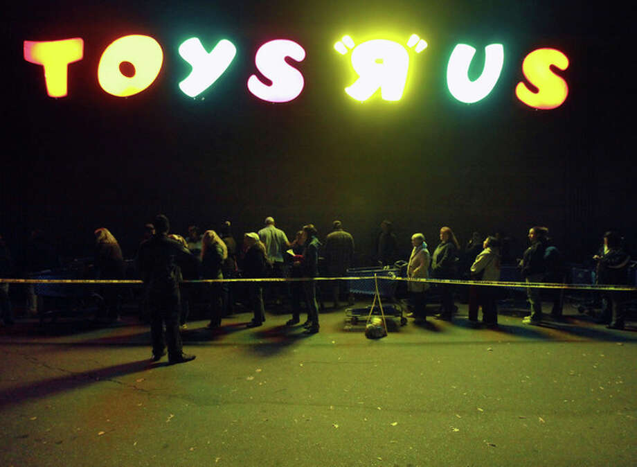 "A line forms outside of Toys ""R"" Us formed before its opening at 8 p.m. as shoppers took advantage of the sales and deals in the earlier shopping period for the typical ""Black Friday"" event on Thursday evening, Nov. 22, 2012 in Chico, Calif. (AP Photo/Jason Halley, Chico Enterprise-Record) / MediaNews Group"