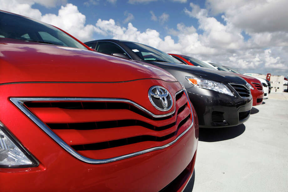 FILE- In this Thursday, Aug. 5, 2010, file photo a 2011 Toyota Camry LE sits on the lot at Kendall Toyota in Miami. Toyota will not relinquish the Camry's spot as America's most popular car in 2013, a top executive told industry analysts on Tuesday, Aug. 2013.(AP Photo/Lynne Sladky, File) / AP