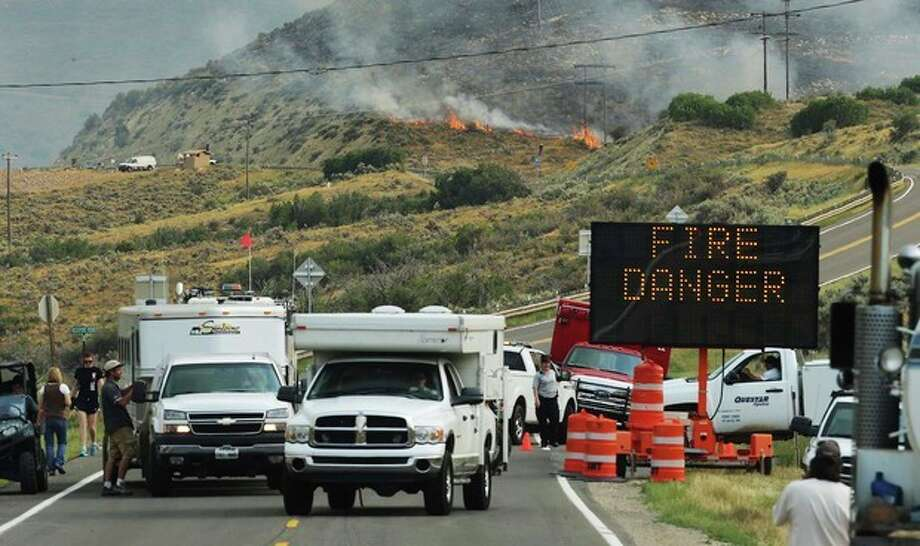 Area residents evacuate as crews work to fight a fire burning near Rockport reservoir, near Wanship, Utah, Tuesday, Aug. 13, 2013. (AP Photo/Deseret News, Scott G Winteton) / Deseret News
