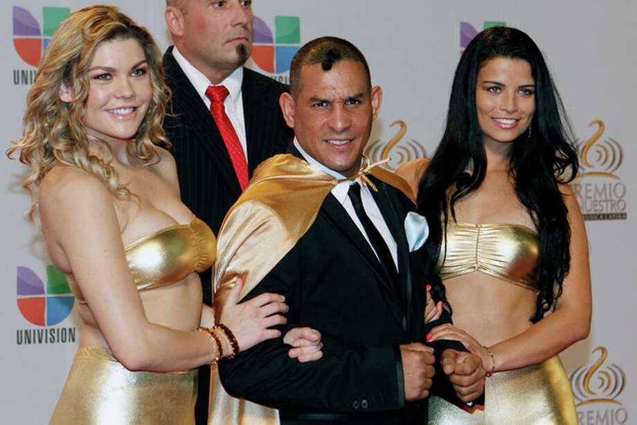 "FILE - In this Feb. 16, 2012 file photo former boxing champion Hector ""Macho"" Camacho, front center, poses for photographers at his arrival to the Premio Lo Nuestro Music Awards in Miami. Police in Puerto Rico say Camacho has been shot and critically wounded Tuesday, Nov. 20, 2012. (AP Photo/Alan Diaz, File) / AP"