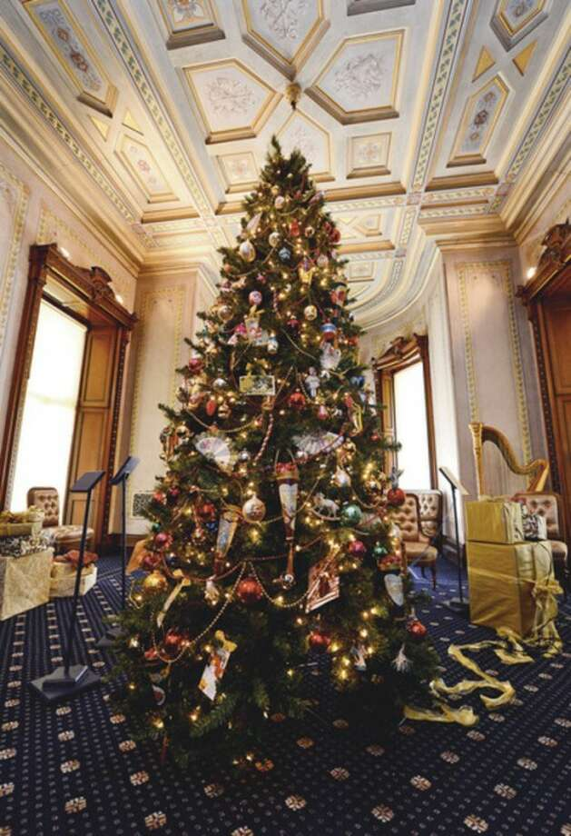 """Hour photo / Erik TrautmannA period tree decorated in the style of the 1880's at The Lockwood Mathews Mansion Museum. The Lockwood Mathews Mansion Museum prepares their Christmas exhibit, """"A Grand Holiday at the Mansion-From Victorian to Modern""""."""