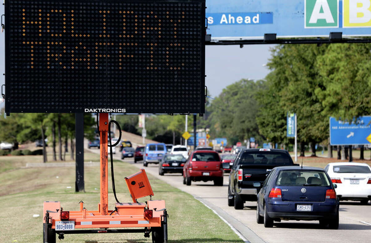 A sign alerts travelers to expect holiday traffic at George Bush Intercontinental Airport Tuesday, Nov. 20, 2012, in Houston. Americans can expect airports to be busier and planes to be fuller than ever, according to a forecast by the main trade association for U.S. airlines released ahead of the holiday. (AP Photo/David J. Phillip)