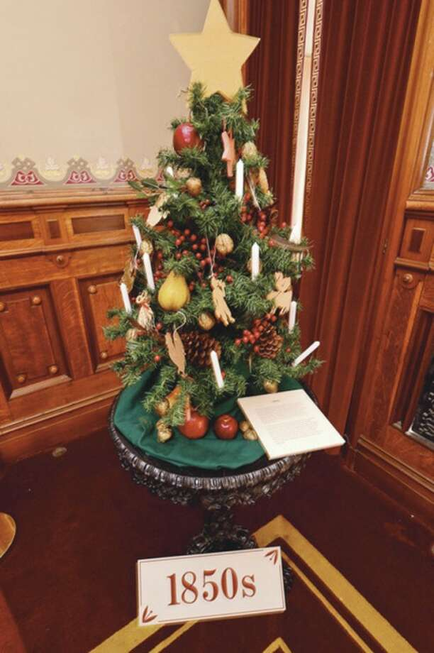 """A Christmas tree decorated in the style of the 1850's at The Lockwood Mathews Mansion Museum. The Lockwood Mathews Mansion Museum prepares their Christmas exhibit, """"A Grand Holiday at the Mansion-From Victorian to Modern"""".Hour photo / Erik Trautmann"""