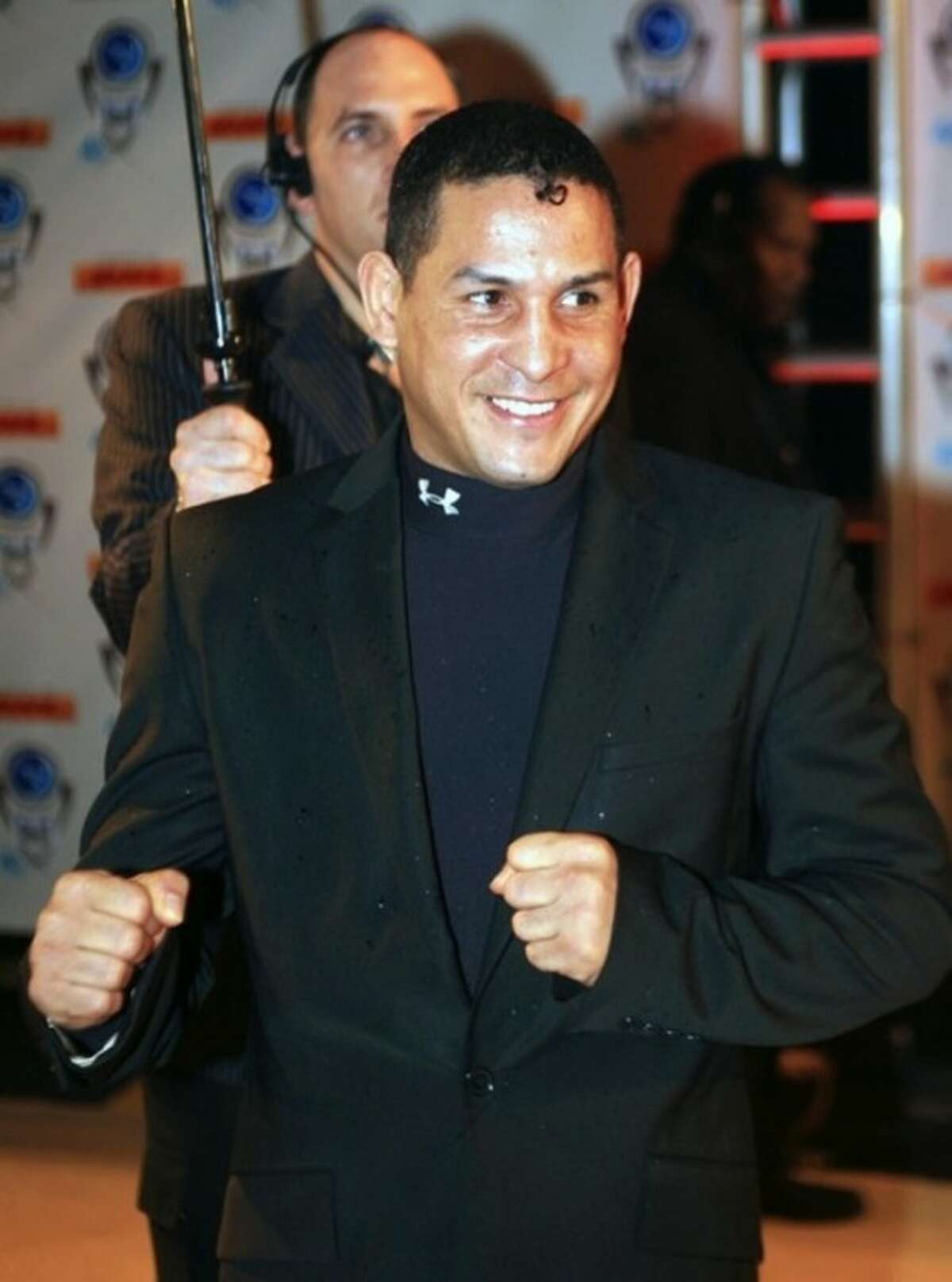 """FILE - In this Dec. 14, 2006, file photo, Hector """"Macho"""" Camacho arrives for an event in Miami Beach, Fla. Police in Puerto Rico say former boxing champion Camacho has been shot and critically wounded. Camacho was shot in the face while in a car outside a bar in Bayamon, one of the cities that make up the San Juan metropolitan area. A statement from police in Bayamon said he was shot Tuesday night, Nov. 20, 2012. (AP Photo/Luis M. Alvarez, File)"""