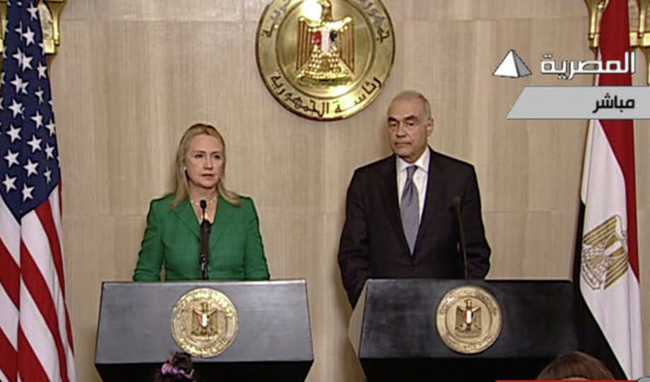 In this image made from Egyptian State Television, U.S. Secretary of State Hillary Rodham Clinton, left, and Egyptian Foreign Minister Mohammed Kamel Amr, right, give a joint news conference announcing a cease-fire between Israel and Hamas in Cairo, Egypt, Wednesday, Nov. 21, 2012. Egypt has announced a cease-fire agreement to end a week of fighting between Israel and Hamas militants in the Gaza Strip. Foreign Minister Mohammed Kamel Amr said the truce would take effect at 9 p.m. local time (2 p.m. EDT.) He made the announcement alongside visiting U.S. Secretary of State Hillary Rodham Clinton. (AP Photo/Egyptian State Television) / Egypt State TV