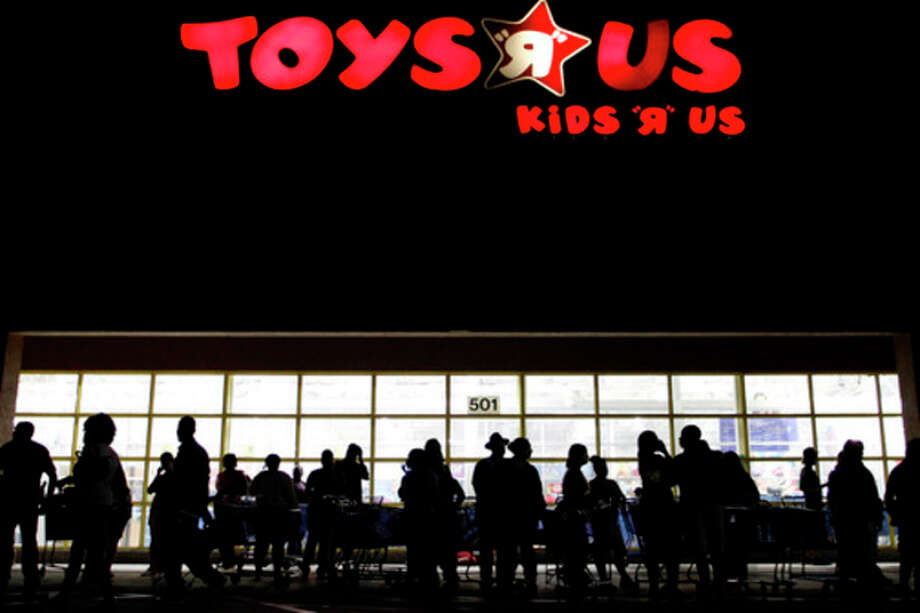 FILE - In this Thursday, Nov. 25, 2010, file photo, people line up outside Toys R Us as Black Friday sales begin o, in Royal Palm Beach, Fla. If the economic downturn has taught retailers anything, it's that a 50 percent off sale isn't enough to lure finicky American shoppers into stores these days, so this holiday season, shoppers will find that retailers are doing all kinds of things to make it easier for them to part with their money. (AP Photo/The Palm Beach Post, Rachel Mummey) MAGS OUT; TV OUT; NO SALES / Palm Beach Post