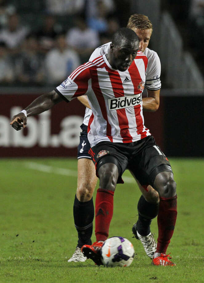 Jozy Altidore of Sunderland controls the ball during the match against Tottenham Hotspur at the Barclays Asia Trophy Wednesday, July 24, 2013. (AP Photo/Kin Cheung)