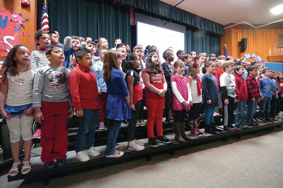 Hour photo / Alex von KleydorffStudents sing the Marine Corps Hymn during a program for veterans at Stark Elementary School in Stamford. / 2012 The Hour Newspapers
