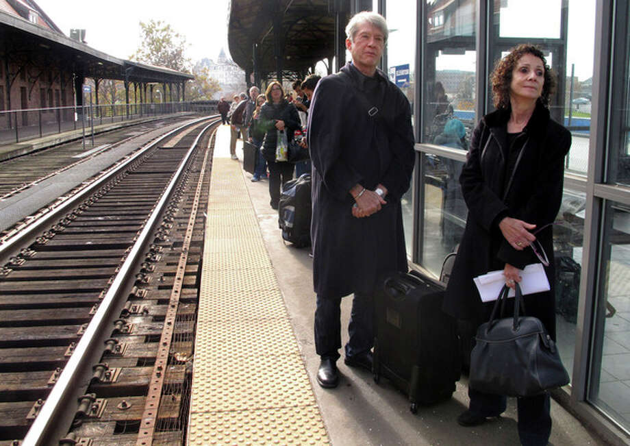 Fred Errington, left, and Deborah Gewertz of Amherst, Mass., wait for an Amtrak train to arrive at Union Station in Hartford, Conn., Wednesday, Nov. 21, 2012. They planned to travel to New York City on the busiest travel day of the year to meet friends for Thanksgiving (AP Photo/Dave Collins) / AP