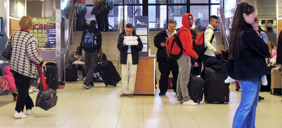 Travelers wait for trains and buses at Union Station in Hartford, Conn., on Wednesday, Nov. 21, 2012, the day before Thanksgiving and the busiest travel day of the year. (AP Photo/Dave Collins) / AP