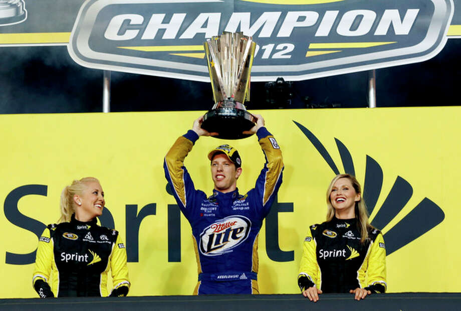 Brad Keselowski celebrates winning the NASCAR Sprint Cup Series championship at Homestead-Miami Speedway, Sunday, Nov. 18, 2012, in Homestead, Fla. (AP Photo/Terry Renna) / FR60642 AP