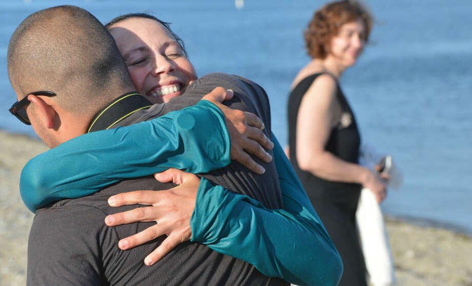 Hour Photo/Alex von Kleydorff. After completeing a coast to coast run Rosalynn Frederick gets a hug from her brother James