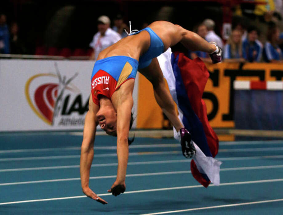 Russia's Yelena Isinbayeva celebrates winning the gold medal in the women's pole vault final at the World Athletics Championships in the Luzhniki stadium in Moscow, Russia, Tuesday, Aug. 13, 2013.(AP Photo/Matt Dunham) / AP